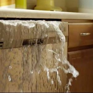dishwasher overflowing with soapy water